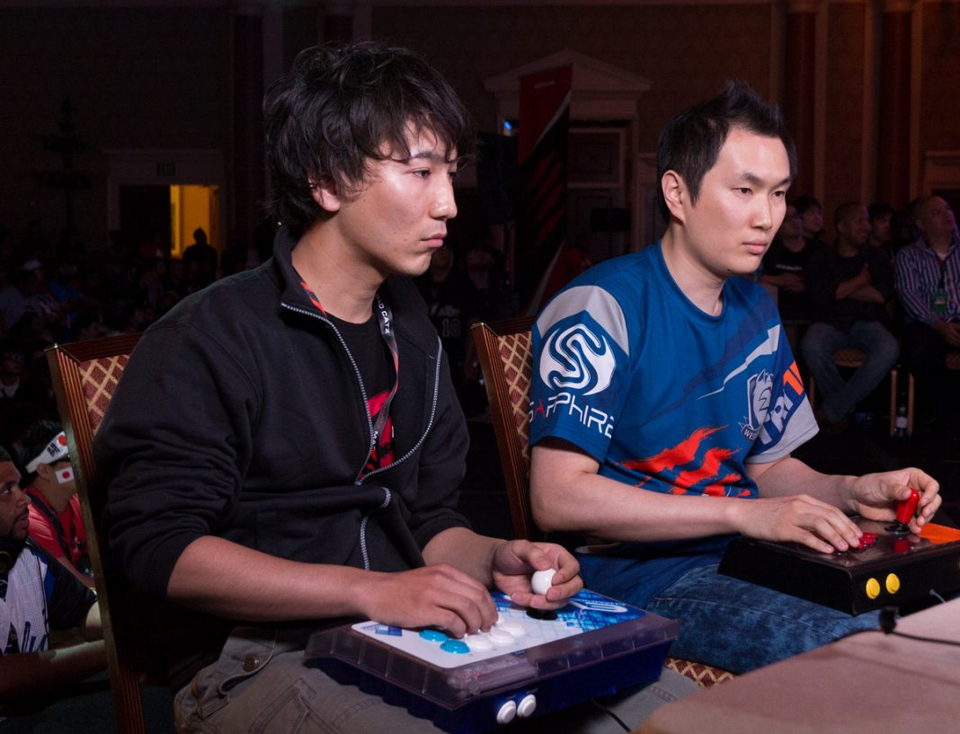 Street fighter players with fightsticks