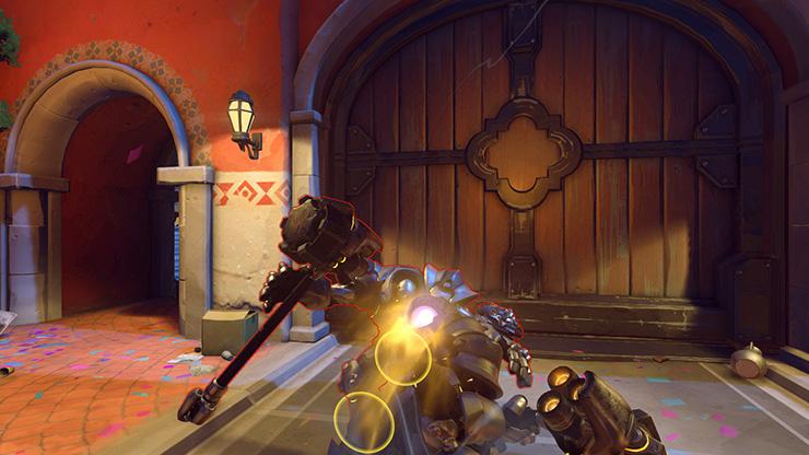 Reinhardt charging at an opponent, preparing to pin them against a wall and make them five kinds of dead.