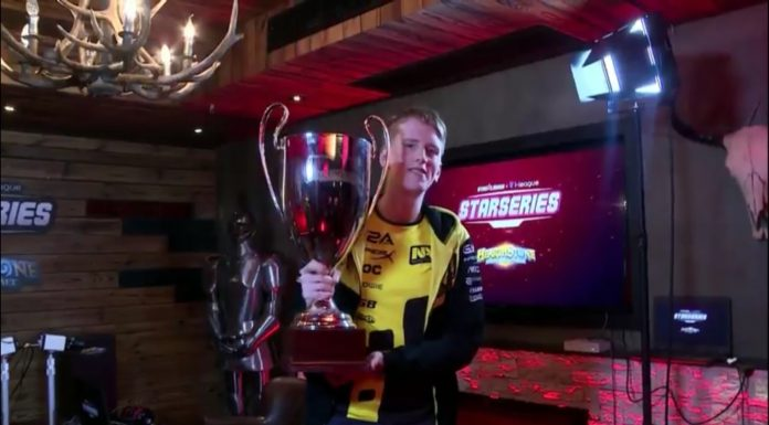 Xixo holding the cup at the Starladder I-League tournament