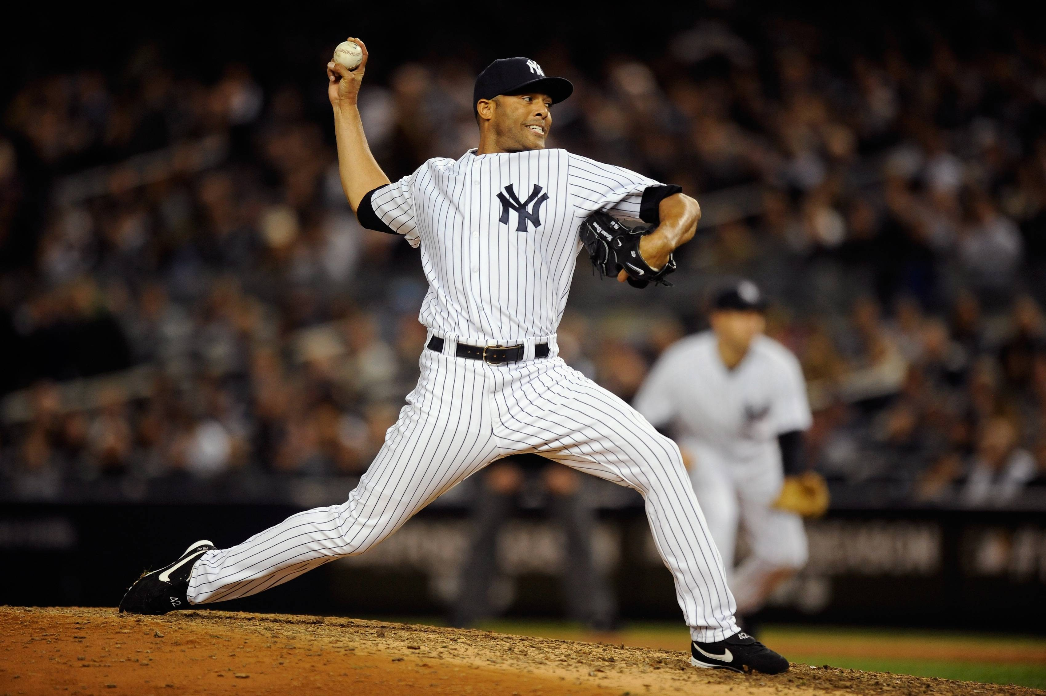 Mariano Rivera, often responsible for closing out Yankees games, prepares a pitch on the mound.