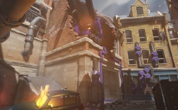 Screenshot from Blizzard's release trailer for the Overwatch: Uprising event shows King's Row, one of the game's maps, in a state of chaos. A car is on fire, and a building has been partially destroyed.
