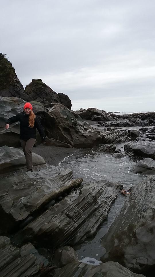 Kara checking out rocks on the coast.