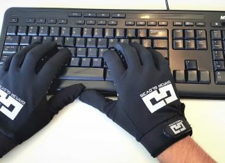 Gamer Gloves being used on a keyboard.