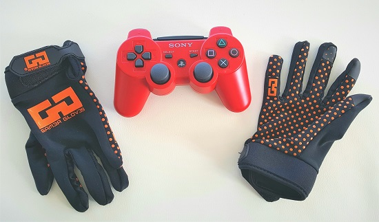 Gamer Gloves with a Play Station controller.